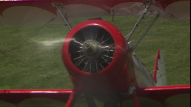 a biplane builds speed for takeoff. - taxiing stock videos & royalty-free footage