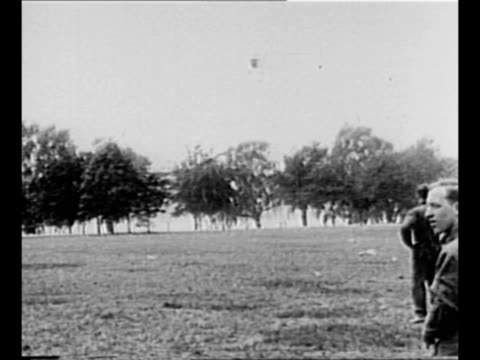 vidéos et rushes de biplane carrying air mail leaves washington dc in 1918 / plane flies / plane swoops over field as two men watch / men unload bags of mail from plane... - composition florale