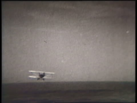 a biplane crash-lands in a field. - biplane stock videos & royalty-free footage