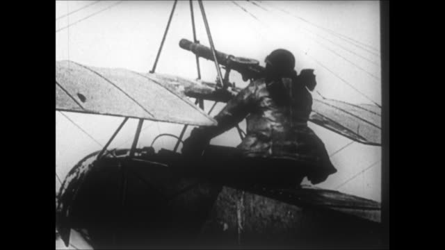 wwi biplane fighter pilot shooting machine gun from cockpit observation balloon on fire and falling to the ground - captain stock videos & royalty-free footage
