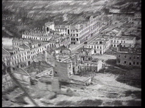 biplane flying over ruins of volgograd city in aftermath of world war ii/ aerial bombed buildings and city in ruins/ cameraman shooting city from... - postwar stock videos & royalty-free footage
