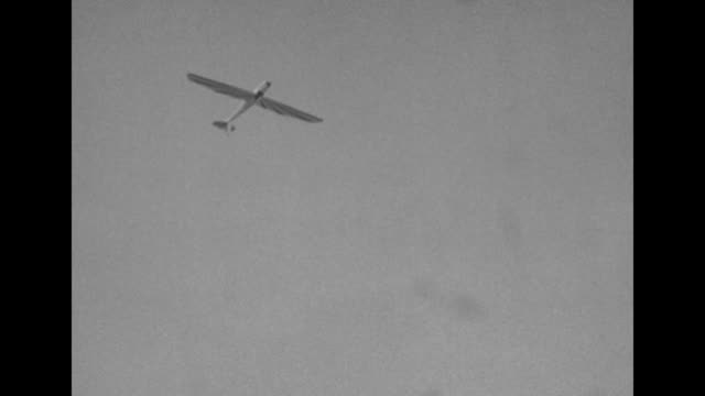biplane in the air with following glider flying upside down doing a looptheloop and diving / on the ground a sailplane comes to stop on airfield at... - pilot stock videos & royalty-free footage