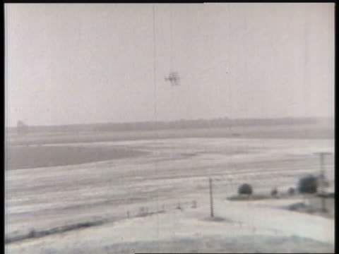 a biplane makes multiple passes over a rural air base. - biplane stock videos & royalty-free footage