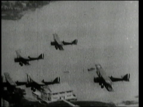 1911 montage bi-planes taking off and flying in formation / united states - 1910 stock videos & royalty-free footage