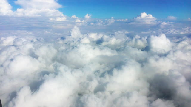 bird eye view, cloud over sky look through plane window view flying high - fighter stock videos & royalty-free footage