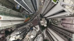 Bird eyes view of Hong Kong cityscape from the drone. 90 degrees aerial view from drone of Hong Kong city. Camera rotate moving from down to top.