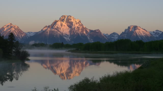 bird flying at sunrise in the grand teton national park - grand teton stock videos & royalty-free footage