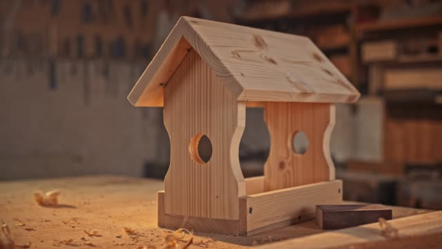 bird house set on the working table in the carpenter's shop - birdhouse stock videos & royalty-free footage