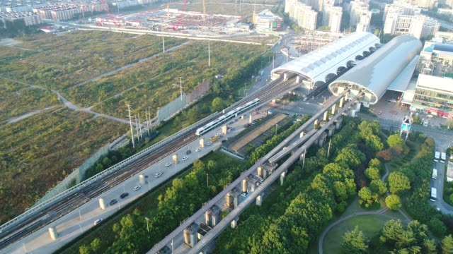 bird view of shanghai maglev (right)  and metro station (left),taken by drone - shanghai stock-videos und b-roll-filmmaterial