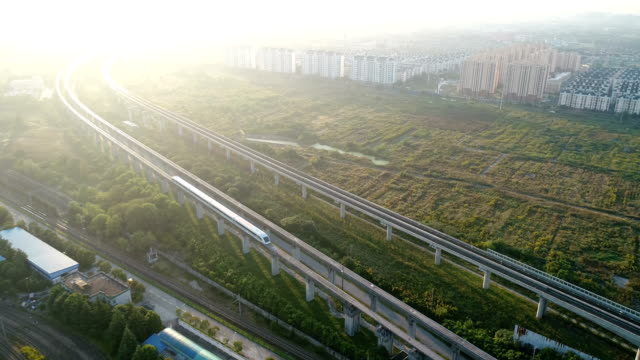 bird view of shanghai maglev and subway line  track in the morning,showing the freedom and peace. left is the maglev track and right is subway line 16 track - shanghai stock videos & royalty-free footage