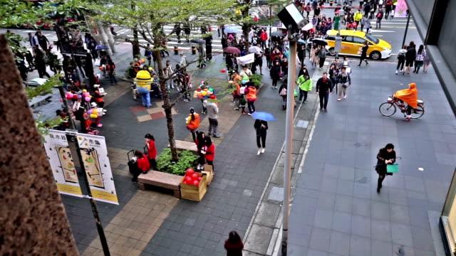 Bird view of the pedestians near shopping plaza, Taipei, China