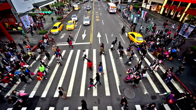 Bird view of the pedestrians go crossing the street in downtown, Taipei, China