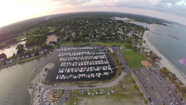 360 birdeye aerial, New England marina during sunset