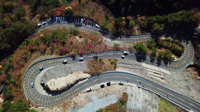 a birds eye view of a mountain pass in autumn - winding road stock videos & royalty-free footage
