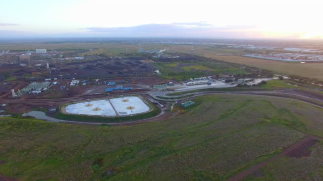 a birds eye view of a sewage treatment plant processing effluent. - david ewing stock videos & royalty-free footage