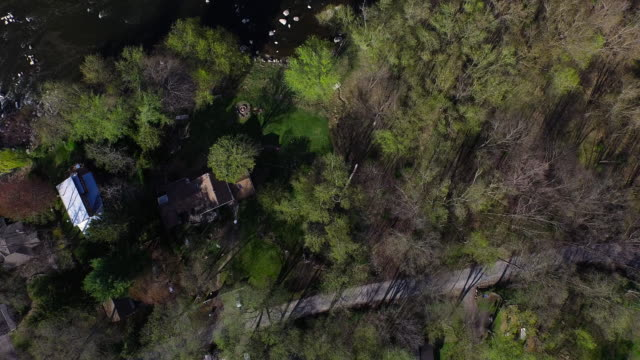 bird's eye view of houses hidden in trees along a rocky river in upstate new york - new paltz ny stock videos and b-roll footage