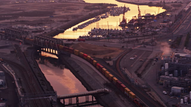 birds eye view of industrial landscape at dusk - port of los angeles stock videos & royalty-free footage