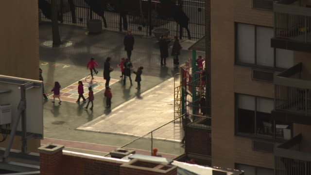 Birds eye view of kids playing on the school playground during recess.