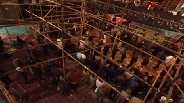 bird's eye view of men performing azadari rituals during ashura at a mosque in isfahan province ashura the tenth day of the islamic month of muharram... - ashura muharram stock videos & royalty-free footage