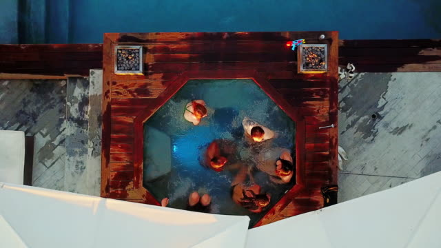 birds eye view of people in hot tub - hot tub stock videos and b-roll footage