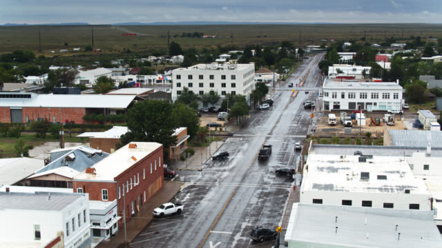 birds eye view of quiet street in marfa, tx on rainy day - - small town america stock videos & royalty-free footage