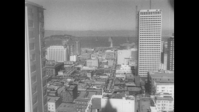 bird's eye view of san francisco cityscape / trolley climbs hill between parked cars / traffic on the highway leading into the city / san francisco... - 1966 stock videos & royalty-free footage