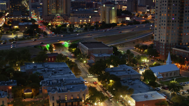 birds eye view of streets bisected by freeway in san antonio at twilight - establishing shot stock videos & royalty-free footage