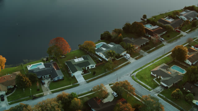 birds eye view of suburban homes - lakeshore stock videos & royalty-free footage