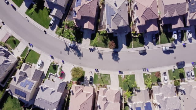 birds eye view of suburbia - housing difficulties stock videos & royalty-free footage