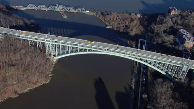 bird's eye view of the henry hudson bridge, a steel arch bridge crossing spuyten duyvil creek between the bronx and the northern tip of manhattan in new york city. - swing bridge stock videos & royalty-free footage