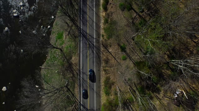 bird's eye view of traffic on one lane running parallel to river in upstate new york - new paltz ny stock videos and b-roll footage