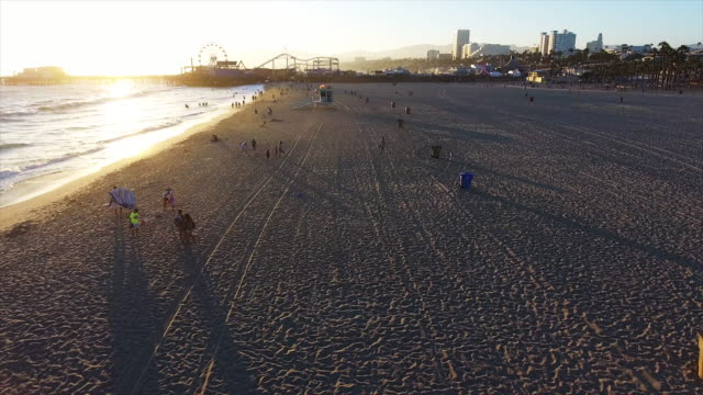 bird's eye view, santa monica beach at sunset - santa monica stock videos & royalty-free footage
