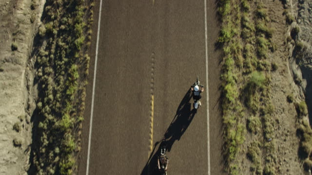 bird's eye view, two men ride motorcycles - motorcycle stock videos & royalty-free footage