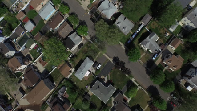 bird's eye view zooming in over light traffic on suburban street in new jersey - zoom effect stock videos & royalty-free footage