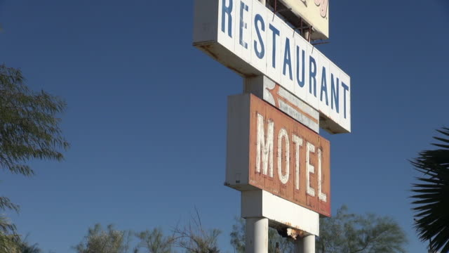 birds fly from old restaurant and motel sign - moving image stock videos & royalty-free footage