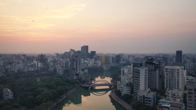 birds flying above the cityscape of dhaka, bangladesh - dhaka stock videos & royalty-free footage