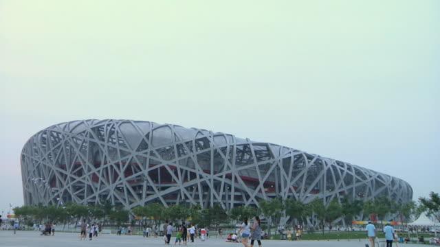 WS Bird's nest Olympic Stadium and pedestrians / Beijing, China