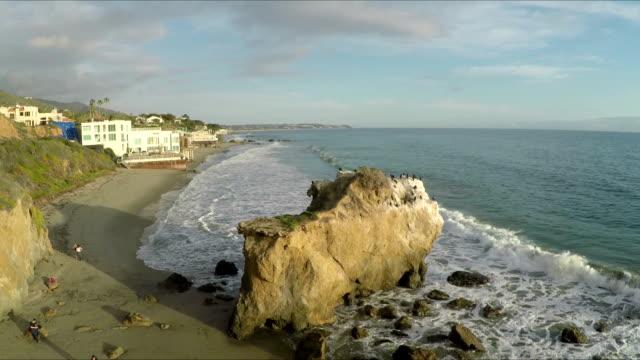 birds on the beach rock in malibu california - modern rock stock videos & royalty-free footage