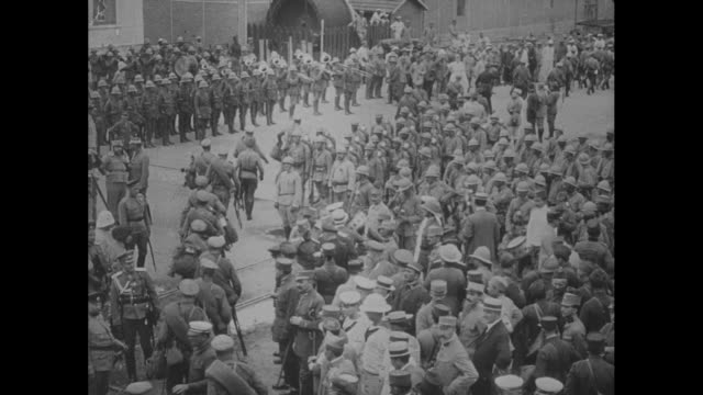birdseye ws crowd in street features soldiers from various allied forces and civilians as a group of soldiers passes by / note film has nitrate... - thessalonika stock videos & royalty-free footage