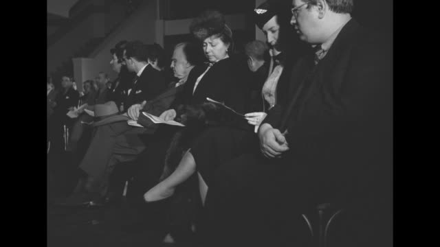 bird's-eye musicians and music lovers seated on stage at the hammond organ company, prior to performances at the 'peace and tolerance in music'... - lotte lehmann stock-videos und b-roll-filmmaterial