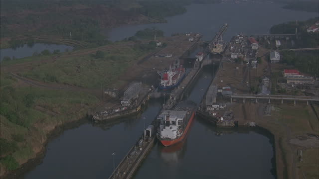 birds-eye of cargo ships going through the gatun lock in the panama canal. - panama canal stock videos & royalty-free footage