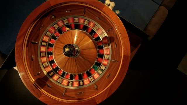 mcu birdseye pan of roulette table - roulette wheel stock videos and b-roll footage