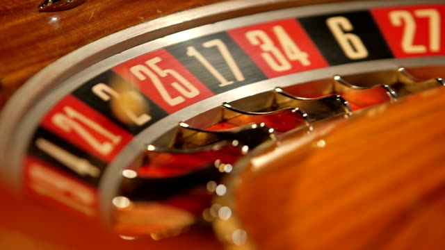 birdseye cu of roulette wheel spinning - roulette stock videos and b-roll footage