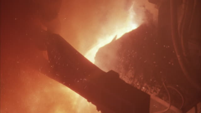 birds-eye shot of a container of hot liquid steel. - foundry stock videos and b-roll footage
