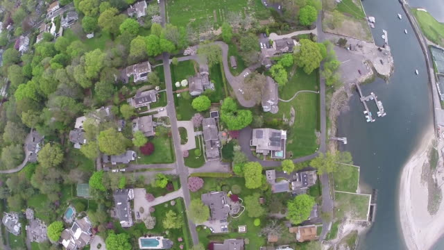 birdseye, sky high aerial view of luxury suburban homes - southport england stock videos & royalty-free footage