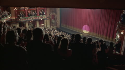 birds-eye view of an applauding audience demanding a curtain call. - theatre building stock videos & royalty-free footage