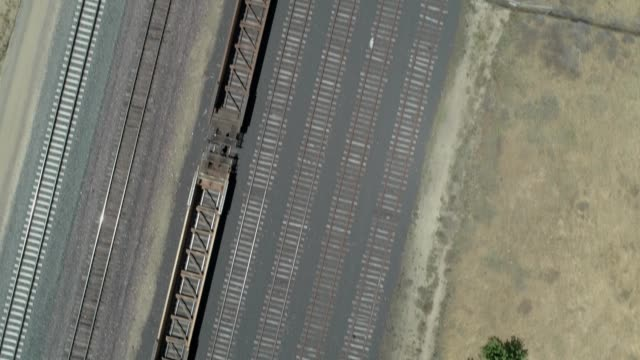 birdseye view of an old train yard by a vineyard in oakley california - tramway stock-videos und b-roll-filmmaterial