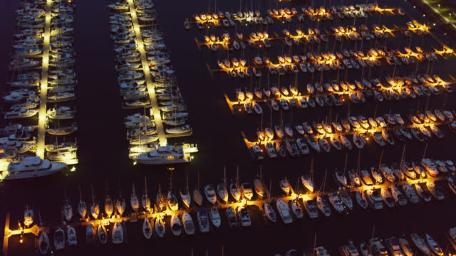 birdseye view of boats in marina at night - anacortes stock videos & royalty-free footage