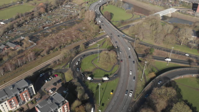 birdseye view of cars driving on flyover - motorway junction stock videos & royalty-free footage
