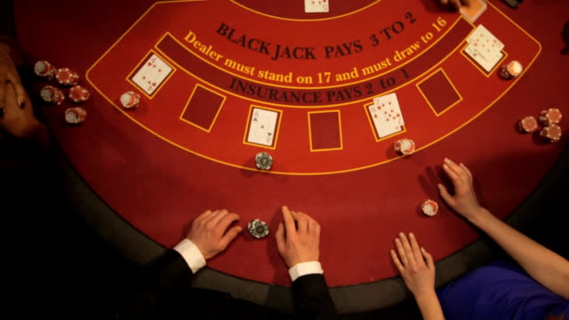 vídeos y material grabado en eventos de stock de birdseye zoom of players gambling in the casino - blackjack